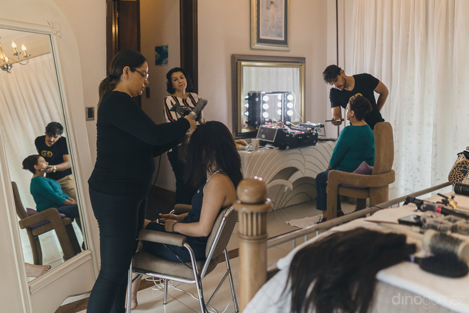 bride has hair and makeup done before her wedding at hacienda ca