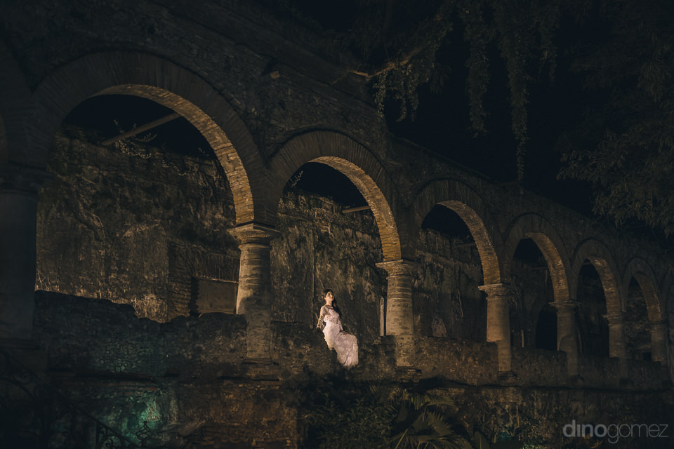 historic mexican hacienda bride stands alone in beautiful weddin