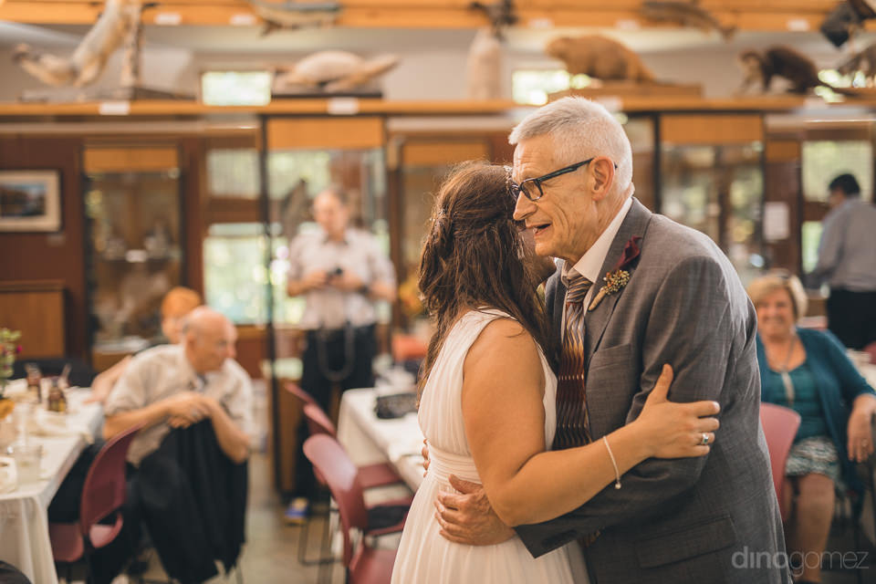 bride dances with father on her wedding day at nature center in