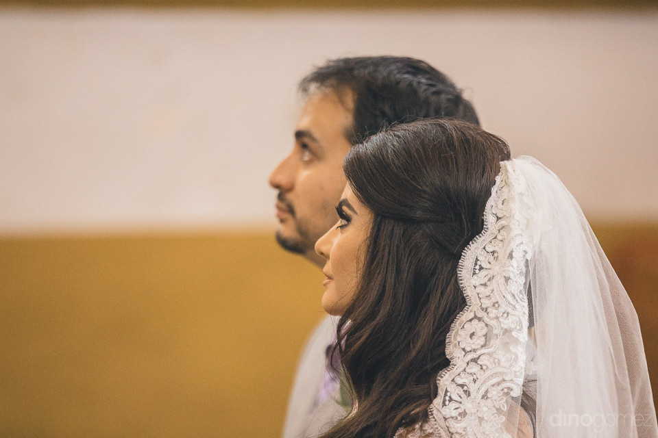 bride and groom sit inside chapel at hacienda casasano during we