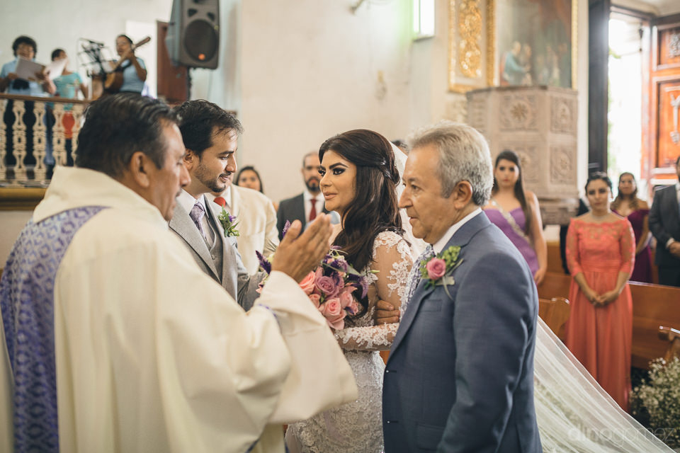 mexican wedding inside church officiated by priest photo by dino