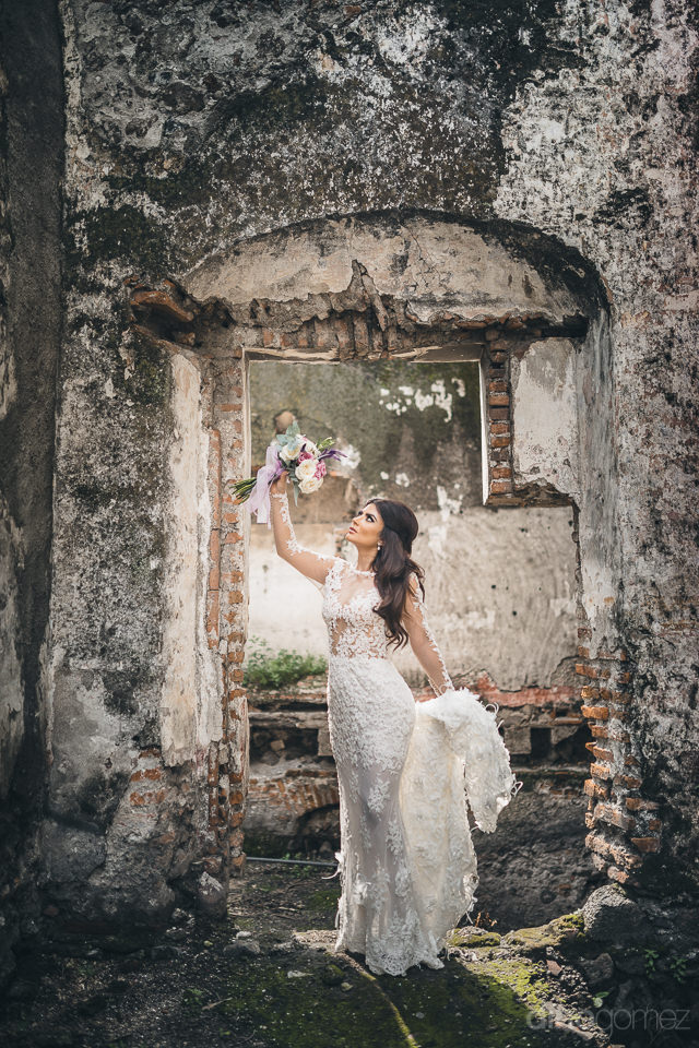 bride posing in doorway of old historic mexican hacienda photo b