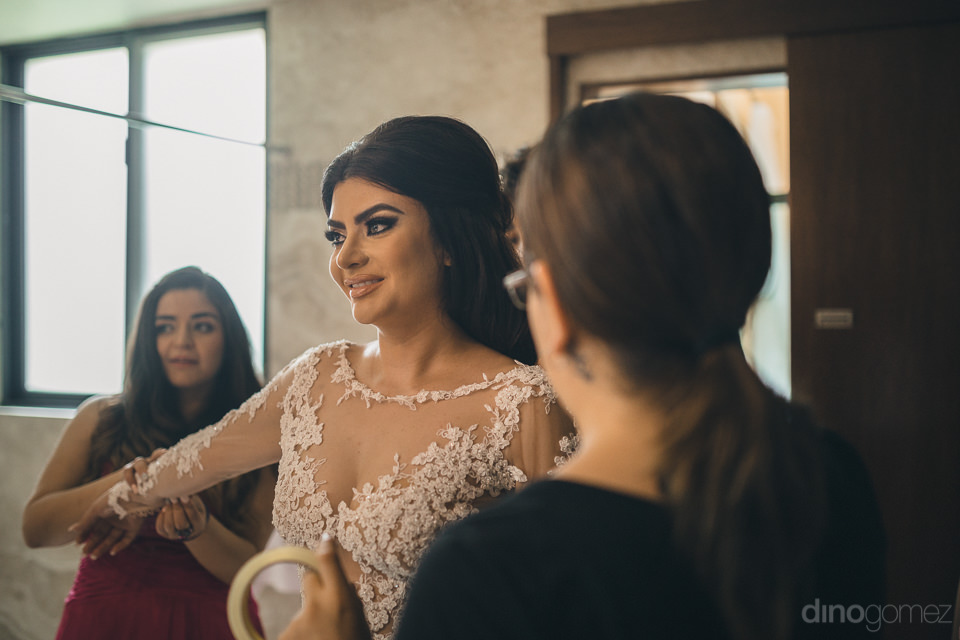 pretty bride on morning of wedding getting ready in photo by mex