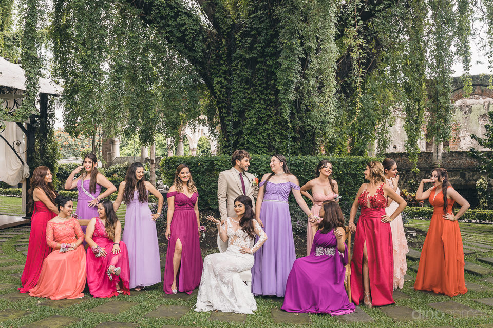 bridesmaids in colorful dresses with bride and best man in green
