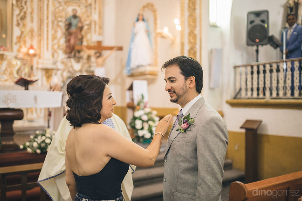 confident groom in mexican church for wedding ceremony in photo
