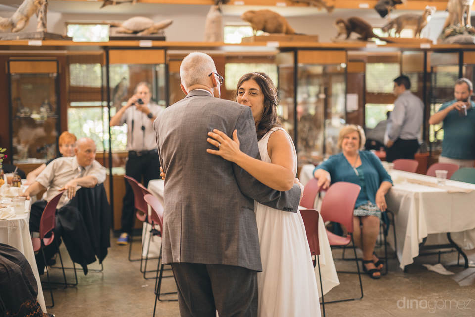 bride has fun dancing with her father on her wedding day in new