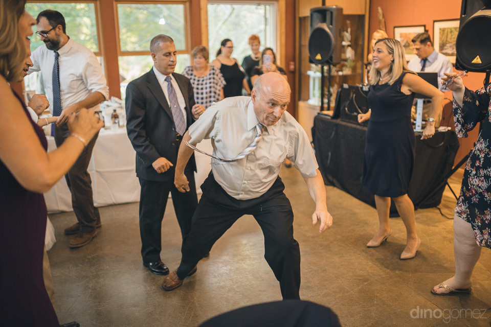 dancing wedding guests have fun at nature center wedding photo b
