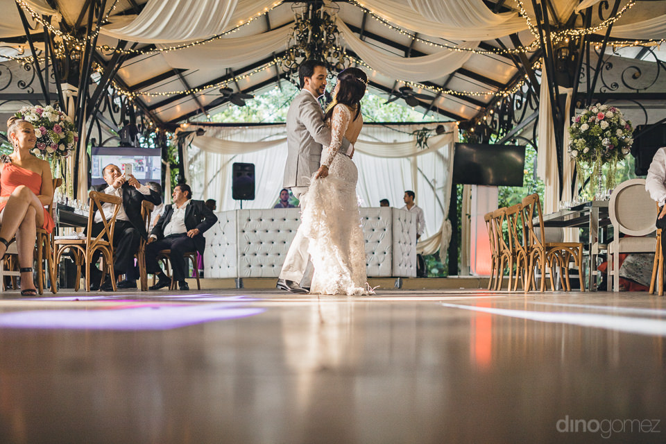 newlyweds have first dance of the night at wedding reception at
