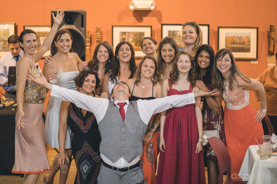 groom and female wedding guests in fun wedding photo by dino gom