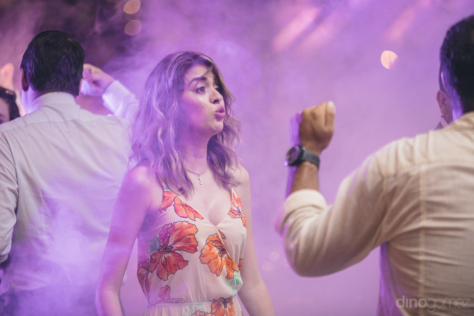wedding guests dance and party amid purple fog at hacienda casas