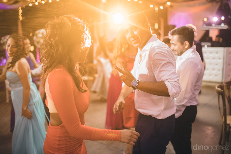 wedding guests dancing at reception photographed by professional