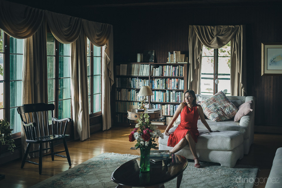 woman sits in elegant and classy lake house in new york photo by