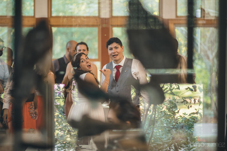 photo of the bride and groom from outside of the nature center d
