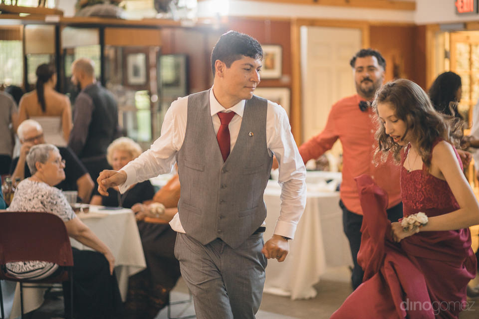 guests dancing with groom on his wedding day in upstate new york