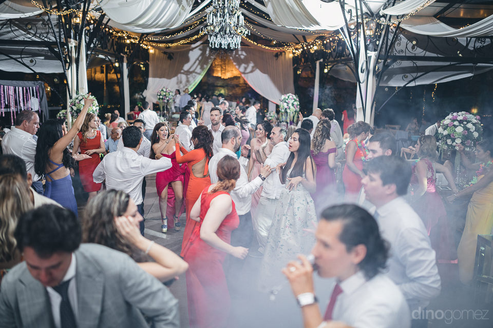 lively wedding reception party with all guests on the dance floo