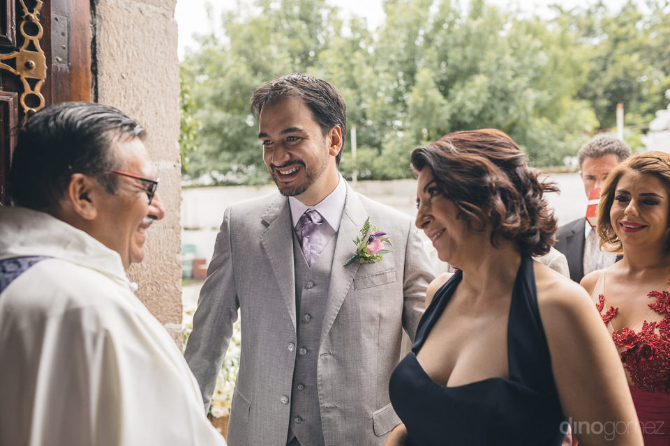 mexican groom arrives to church for wedding ceremony photo by di