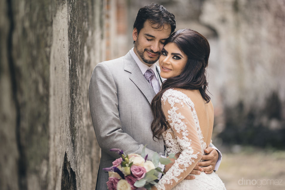 bride and groom embrace in heartwarming wedding photo at haciend