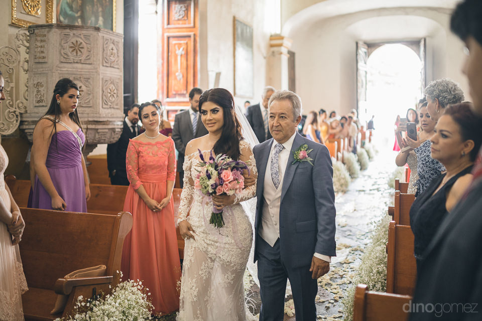 mexico church wedding ceremony bride walks down aisle