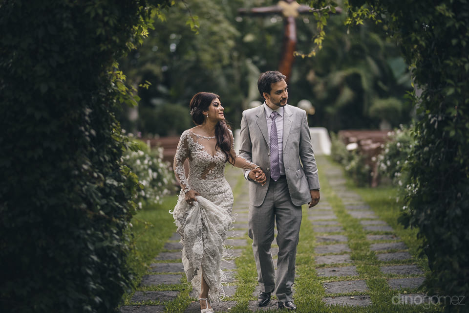newlyweds explore the grounds of their mexican hacienda in photo