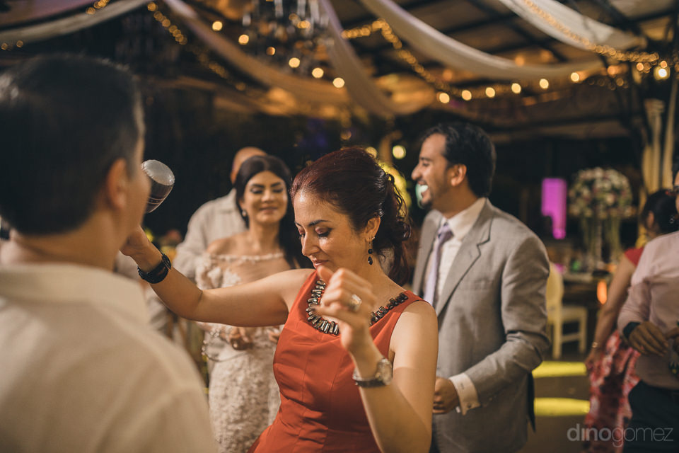 newlyweds laugh and enjoy their wedding reception in photo by di