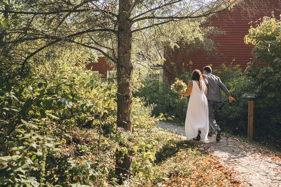 newlyweds run behind lake house into woods