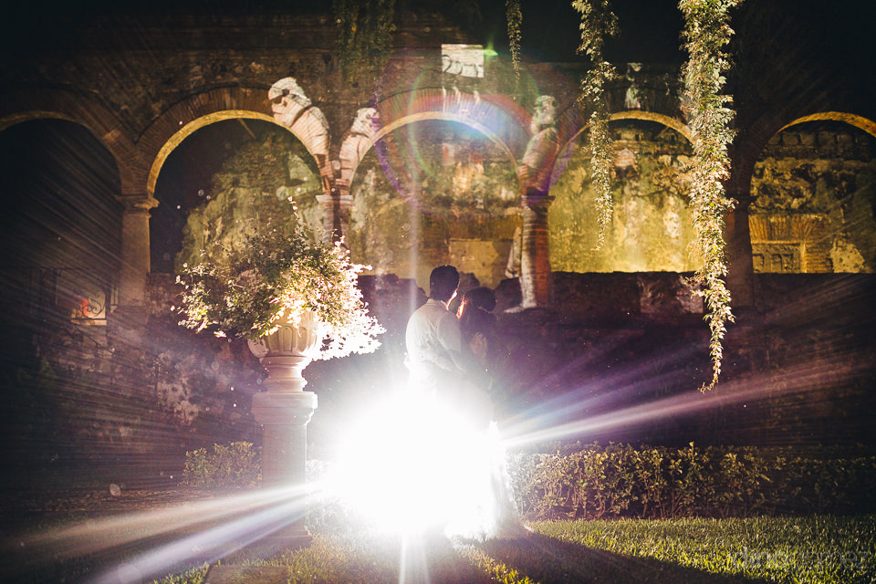 newlyweds light up the night in artistic wedding photo by dino g