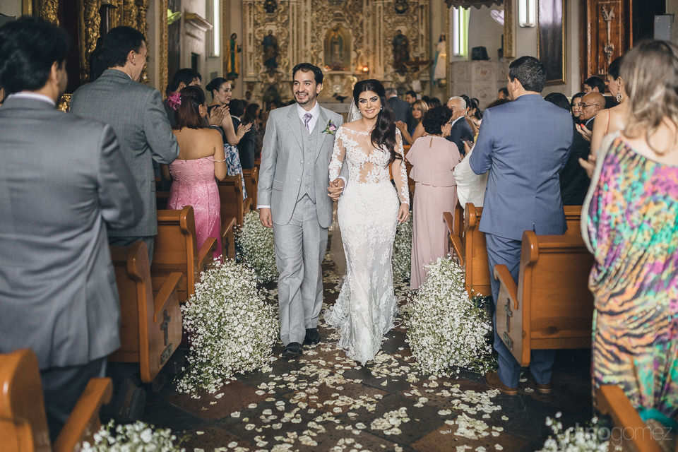 newlyweds walk out of church together as husband and wife