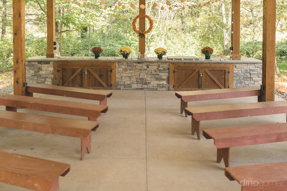 wedding pews and altar with flowers outdoors at baltimore woods