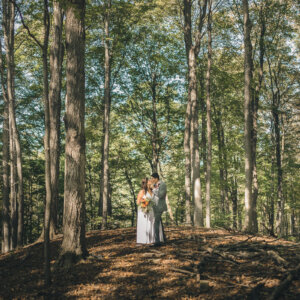 newlyweds in forest in upstate new york on wedding day
