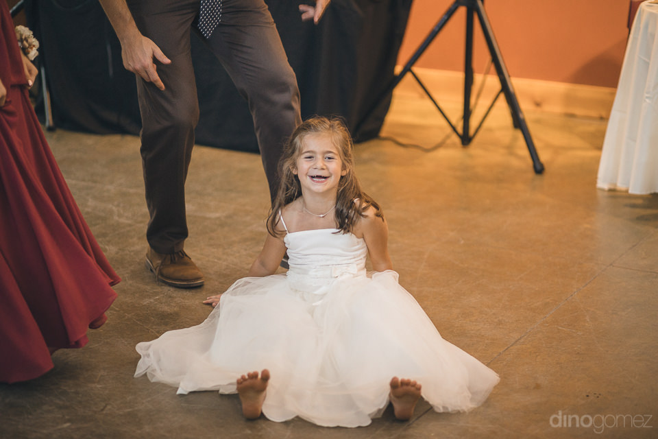 cute girl in dress on dance floor at wedding reception