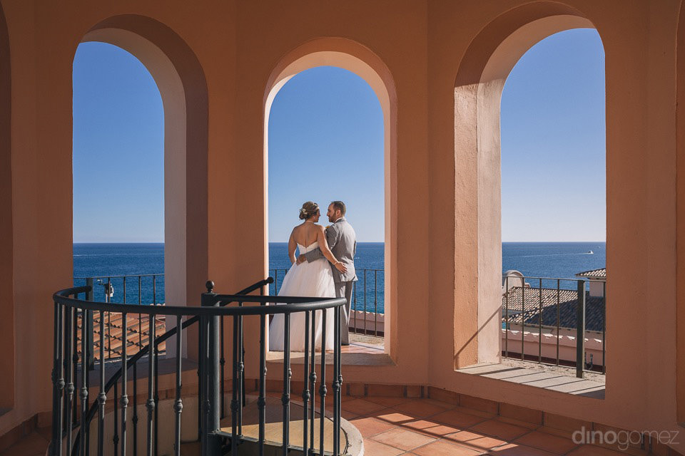 Bride & Groom on top of a tower after their first look- Jo & KC's Wedding in Cabo