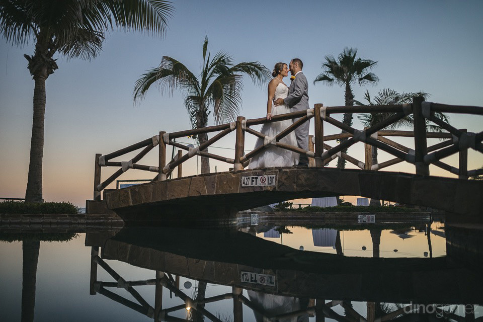 Bride & Groom standing on a bridge kissing - Jo & KC's Wedding in Cabo