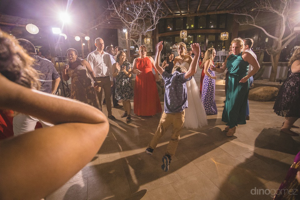Kid jumping in the middle of the party - Jo & KC's Wedding in Cabo
