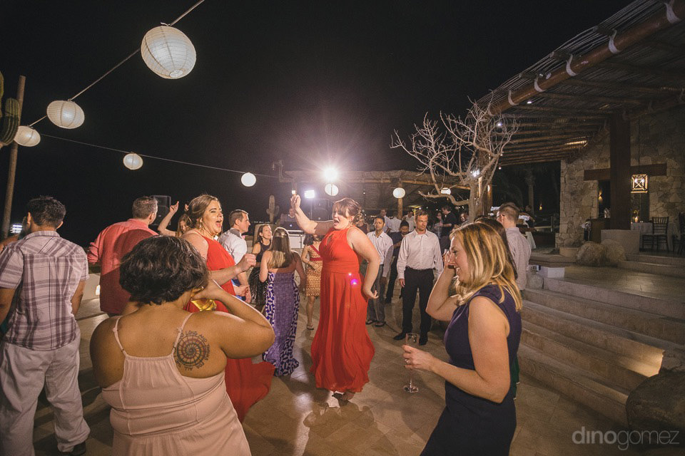 people having fun at reception dancing - Jo & KC's Wedding in Cabo
