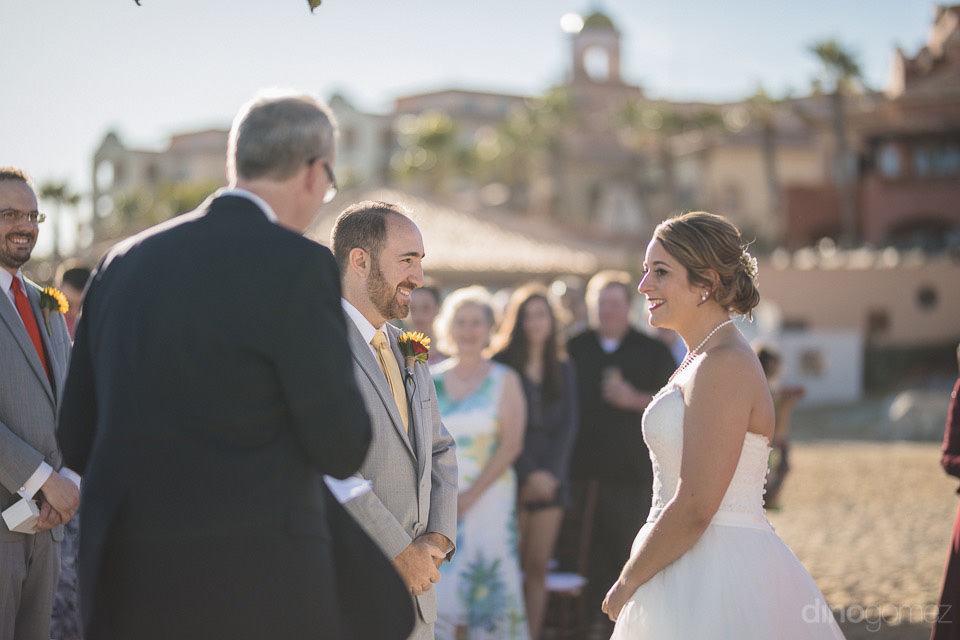 couple smiling at their wedding ceremony - Jo & KC's Wedding in Cabo