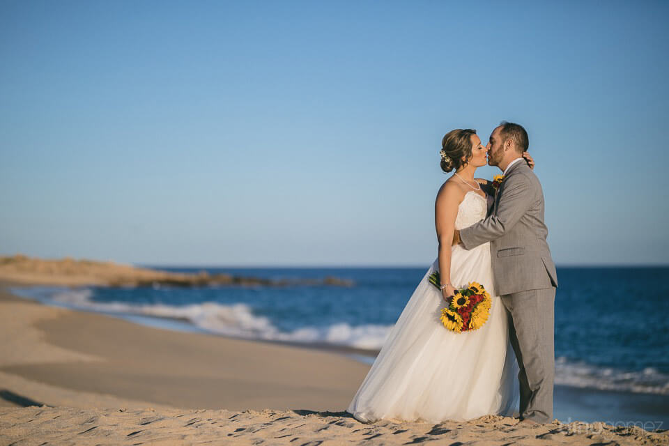 bride and groom kissing on the beach - Jo & KC's Wedding in Cabo