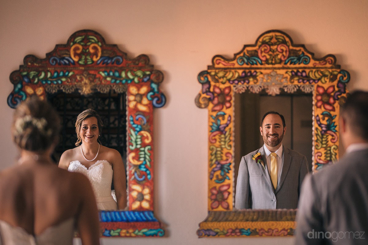 Bride and groom looking into individual colorful mirrors - Jo & KC's Wedding in Cabo