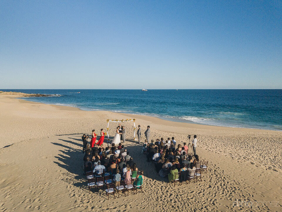 Drone shot of the ceremony on the beach - Jo & KC's Wedding in Cabo