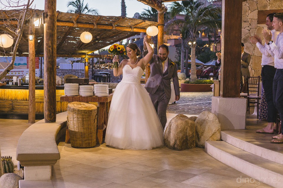 Couple walking in their reception - Jo & KC's Wedding in Cabo