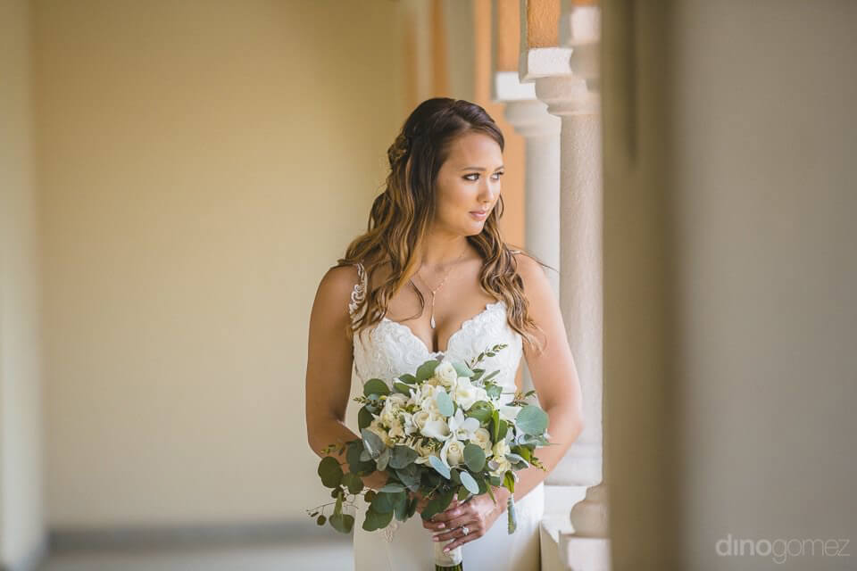 Bride looking out the window - Chiara & Jeremee