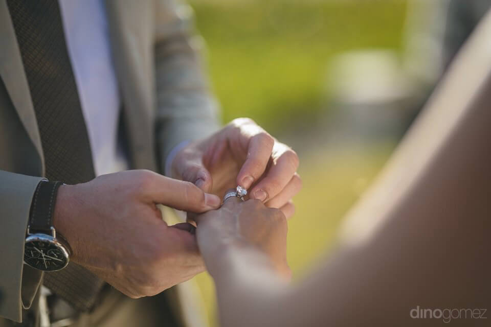 The groom putting the ring on - Chiara & Jeremee
