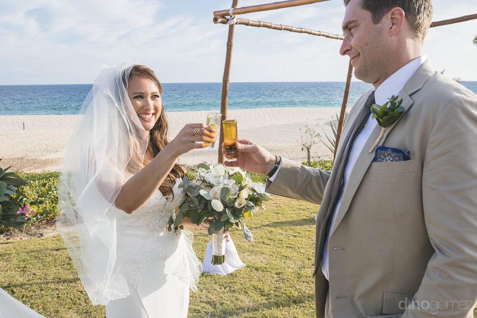 Newlyweds toasting tequila - Chiara & Jeremee