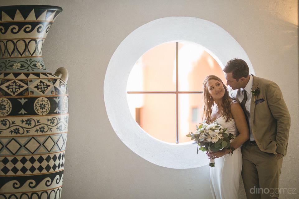 bride and groom beside a tall jar - Chiara & Jeremee