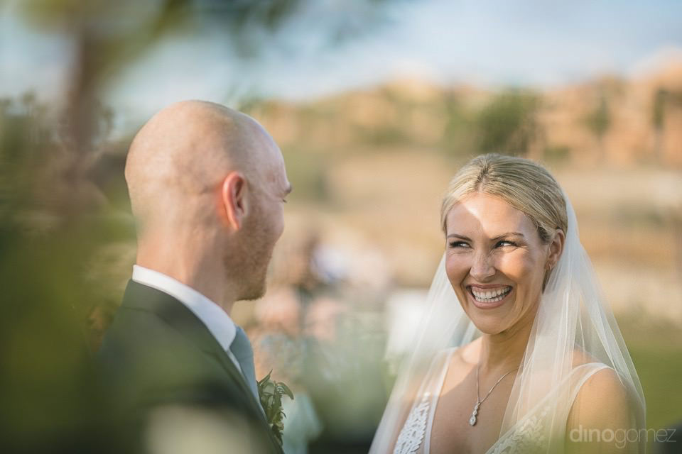 The bright smiling at the groom - Megan & Andrew's Wedding