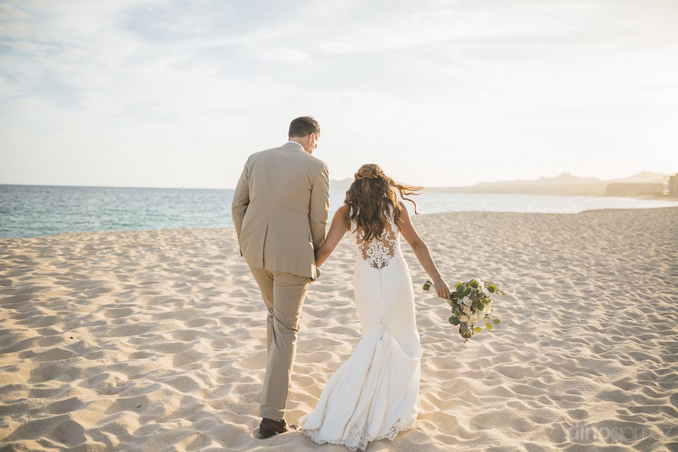 bride and groom walking on the beach - Chiara & Jeremee