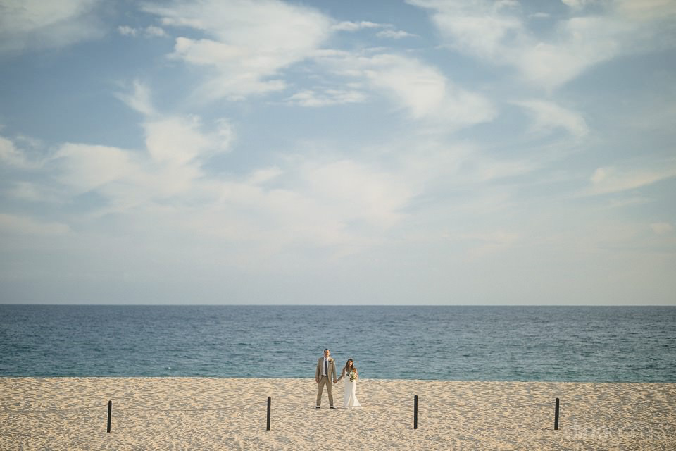 wide shot of the newlyweds on the beach - Chiara & Jeremee