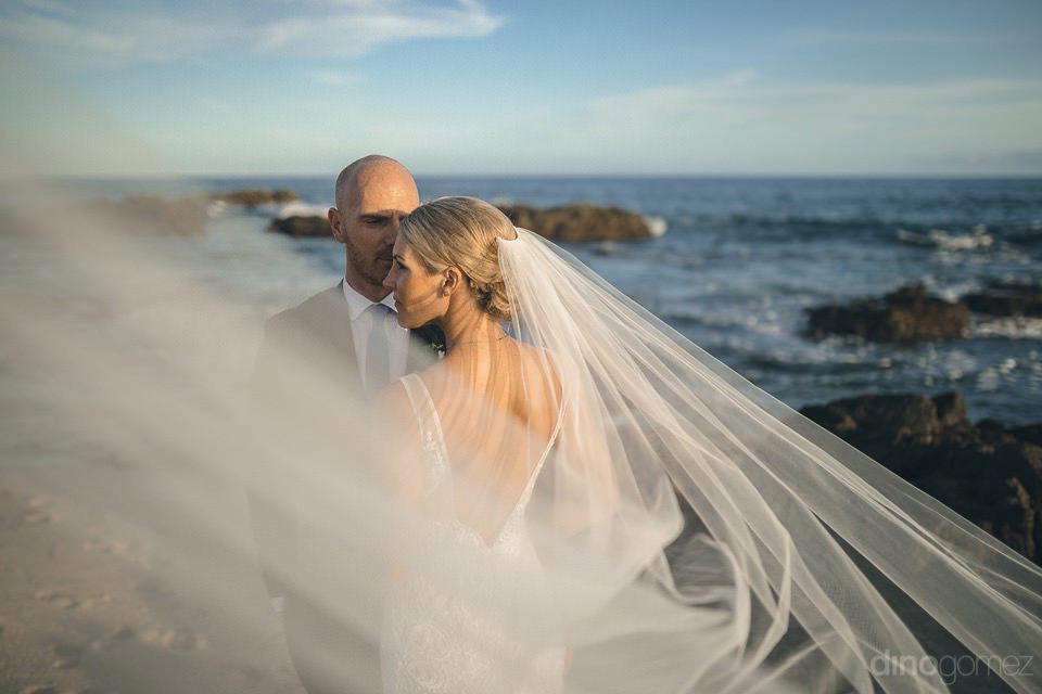 Artistic Picture Of The Bride And Groom On The Beach - Megan & Andrew'S Wedding