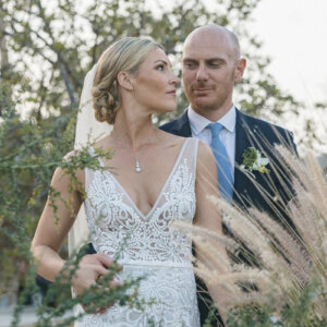 Newlyweds in front of tall grass - Megan & Andrew's Wedding