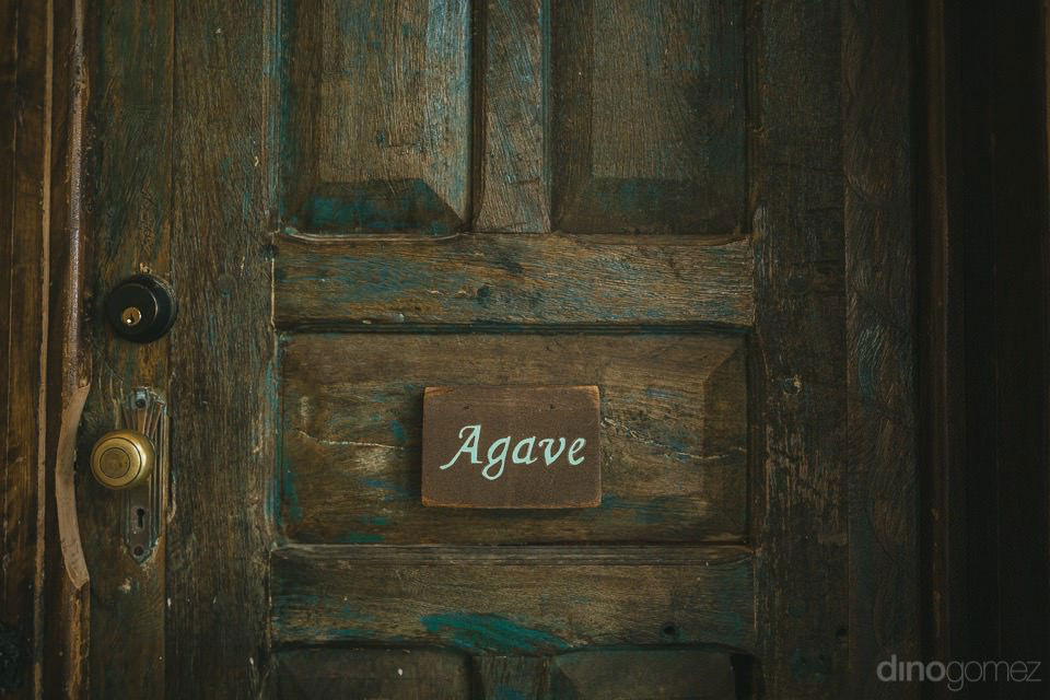 An AGAVE sign on a door - Rachel & Destin