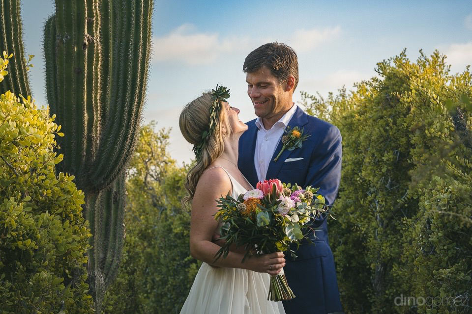 couple kissing next to a cactus - Rachel & Destin
